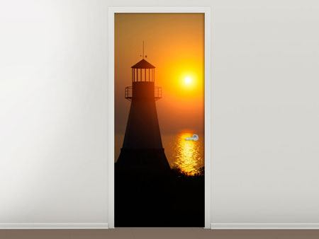 Door Mural A Lighthouse At Sunset