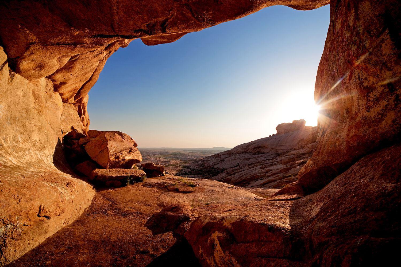 Fototapete Sonnenuntergang vor der Höhle